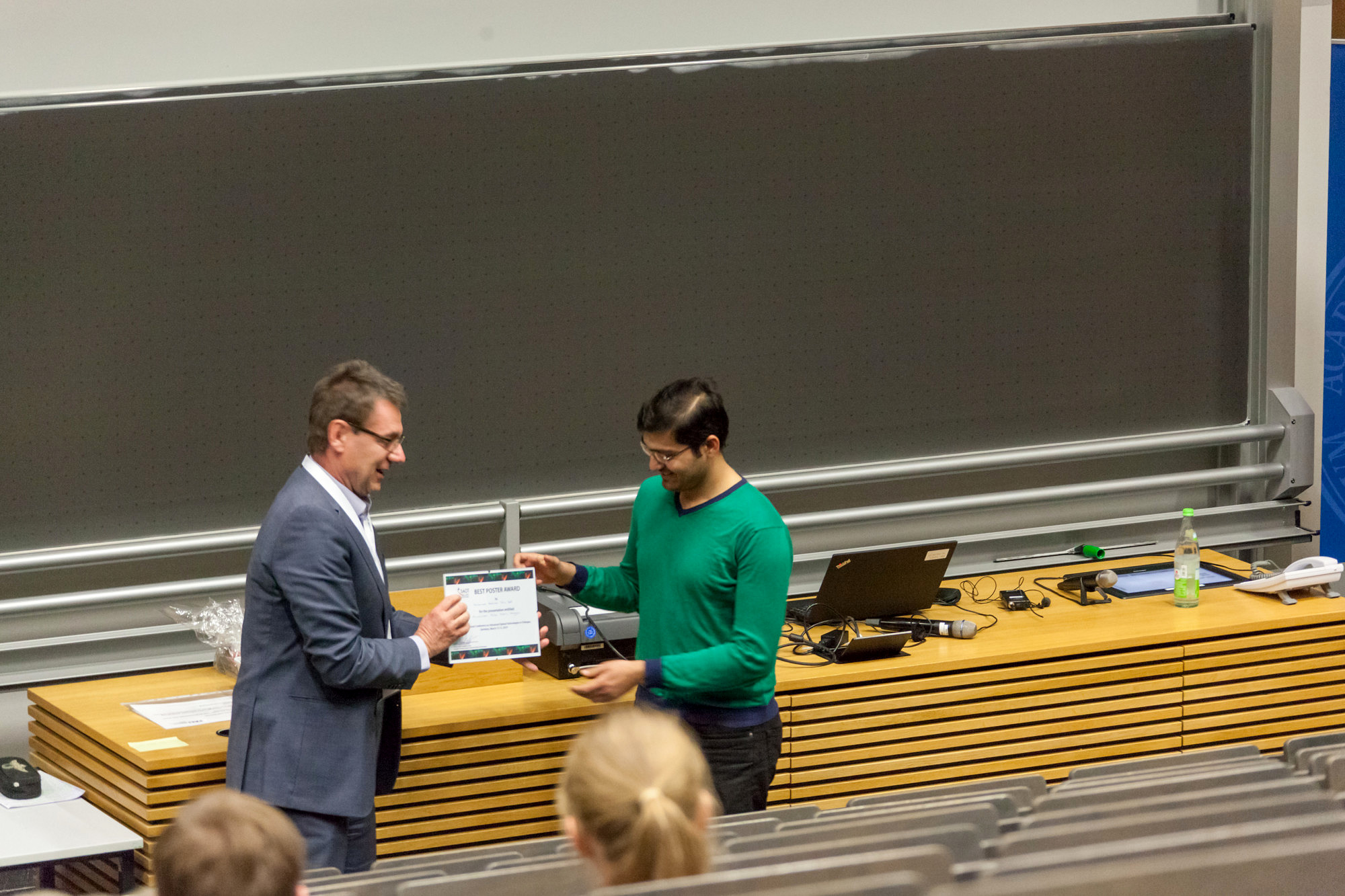 "Muhammad Abdullah Butt (MPL Erlangen) receiving the Best Poster Award for his presentation entitled ""Microscopic Müller Matrix Analysis""."